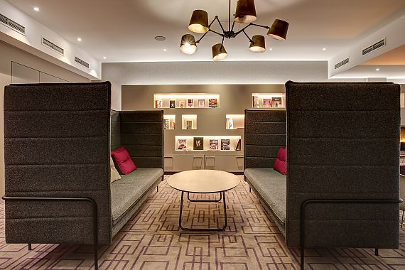 The library at FourSide Hotel Braunschweig offers a modern, relaxed setting to get some work done